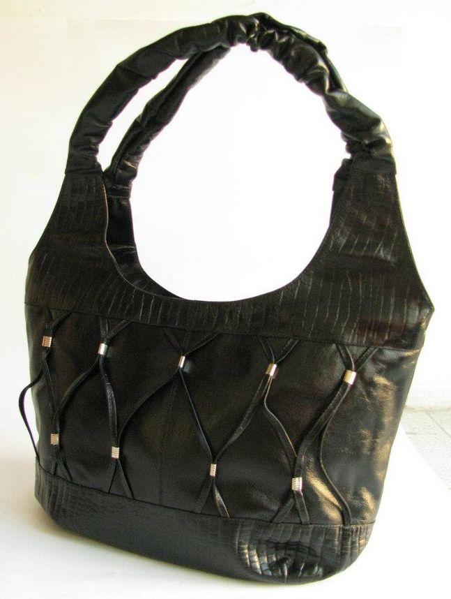 STYLE MAYAN. MATERIAL 100% LEATHER, TEXTILE LINING.