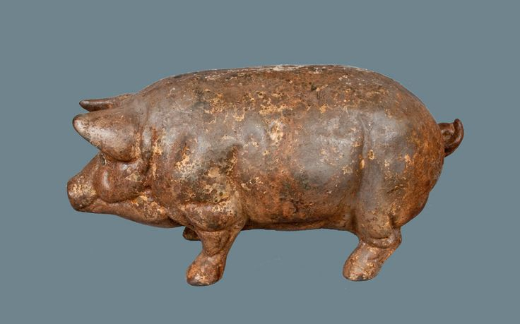 Folk Art Cast Iron Pig -- June 9, 2012 Antiques Auction by Crocker Farm, Inc. late 19th Century likely used as a butcher's advertising piece.  Sold $1,610.00  Includes the buyers premium