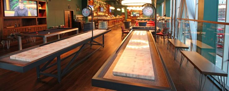 Shuffleboards- We have recently built at least 5 of these behemoths for London bars, including The Burdock at the newly opened Montcalm Hotel in Finsbury Square and The Greenwood at Nova Victoria. By applying custom graphics to the timber playfield before pouring the clear epoxy we have been able to introduce the client's corporate branding to the tables, and the finished results are spectacular.