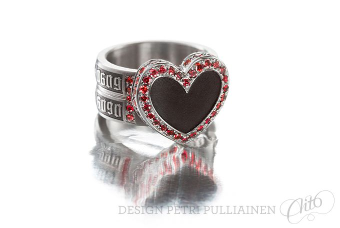 Black diamond coated, laser engraved stainless steel rock'n'roll wedding ring with 88 cherry red diamonds. Photo Mikael Pettersson