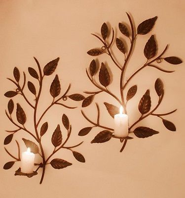 pair of wrought iron wall mounted candle holders tree leaves