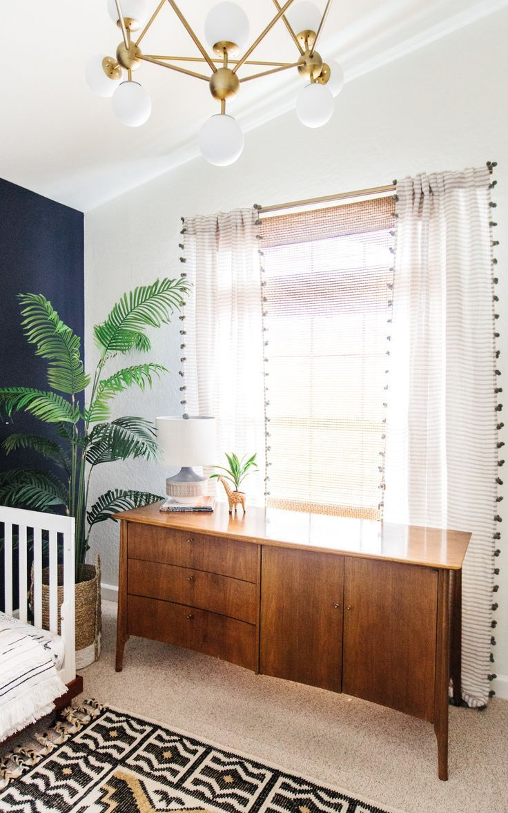 Mid century modern curtains drapes - Midcentury Credenza With Pom Pom Curtains Behind It And A Modern Light Fixture