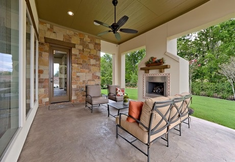 A White Stucco Fireplace Contrasts With Stone Accents. The Covered Patio Of  The 6734 Plan From Darling Homes At Lake Voyageur. The Woodlands, TX.