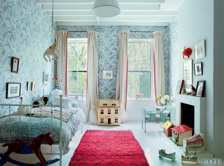 Poppys Marthe Armitage wallpaper is hand-printed with butterflies, birds, and spiderwebs. The rug, like all in the house, was found by Brooks while she worked on a project in Morocco.