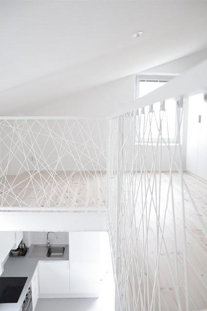 Love this modern white mezzanine bannister!