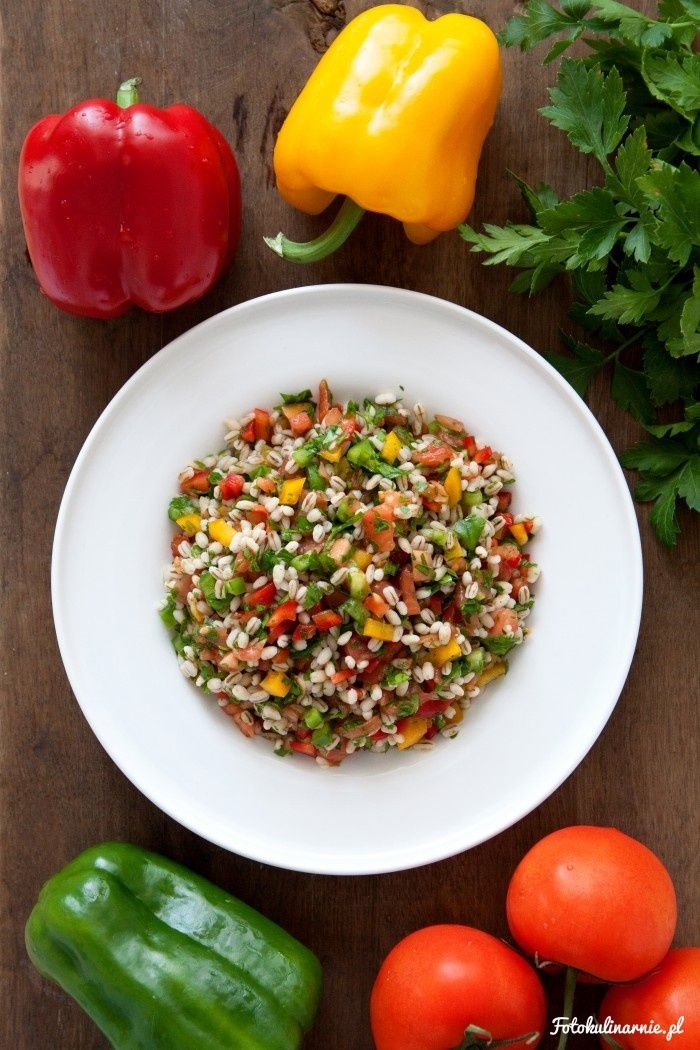 Pearl barley groats, peppers and green parsley healthy salad.