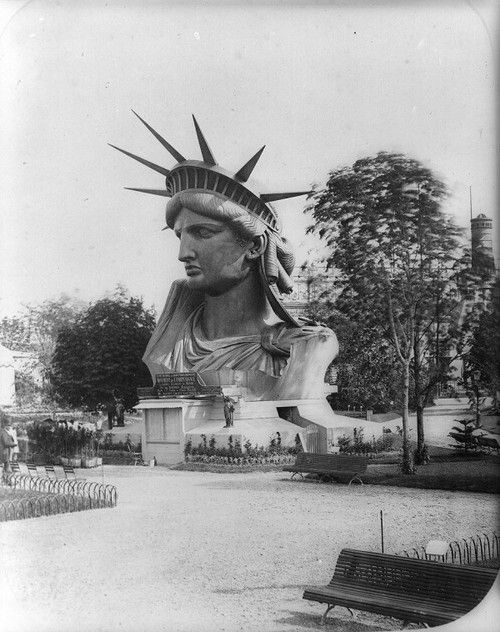 This photo from 1883 shows the completed head of the Statue of Liberty, on display in a Paris park.