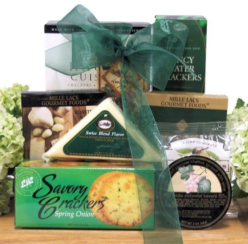 This distinctive gift basket offers a nice assortment of gourmet cheeses, crackers, nuts and snacks The gourmet delights are arranged perfectly on a beautiful wooden cheese board A perfect gift for any occasion Great Arrivals Gourmet Cheese Gift, Board Treats