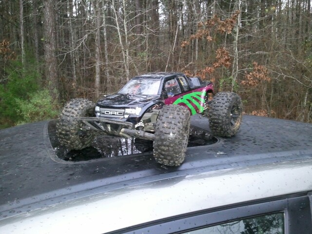 Traxxas rustler vxl with a jconcepts Ford raptor body and 5 inch proline badlands