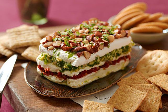 This Layered Sun-Dried Tomato and Artichoke Spread looks complicated to make, so we've included step-by-step photos to prove to you that it's not!