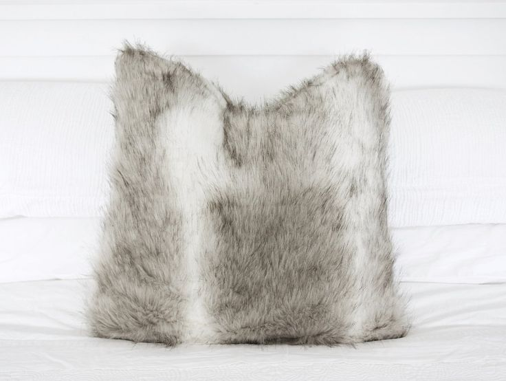 Wolf Faux Fur Cushion NZ $35, a functional addition to any room.