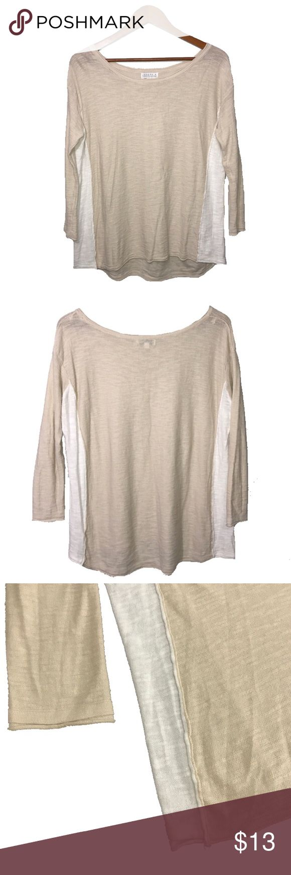 Tan/Beige & White Thin Knit Sweater This Tan/Beige & White Thin Knit Sweater by Joseph A. will become one of your go-to pieces. The all over delicate, beige fabric is completed with white stripes down the sides. The wide, rounded neckline can be worn off or on the shoulder. The slouchy, oversized fit makes sets this top apart from others in your closet. Very soft - 56% cotton, 44% rayon. This is a size SM but could easily fit a size M. Excellent condition. Tops