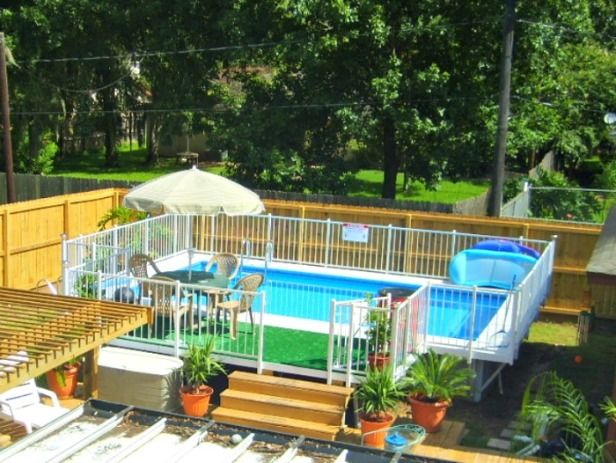 Small yard above ground pool designs kayak swimming for Above ground pool decks houston tx