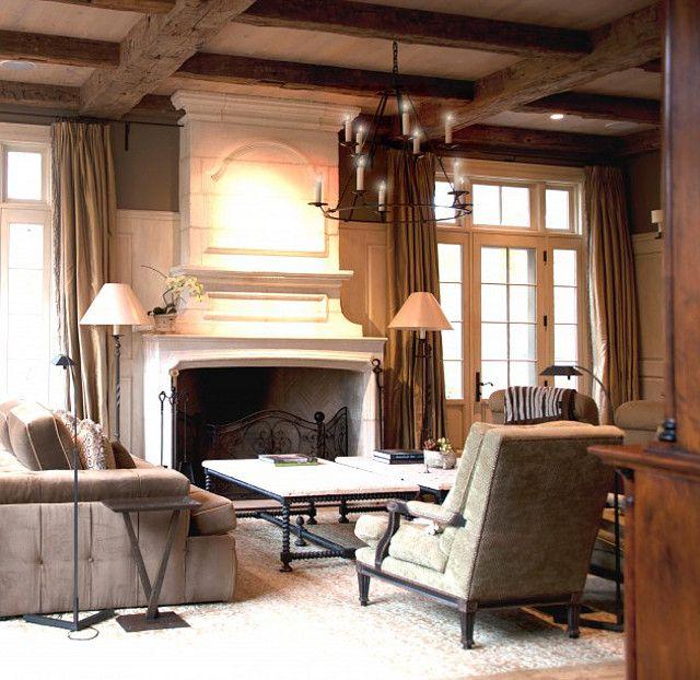 Wood beams, neutral furnishings, french doors