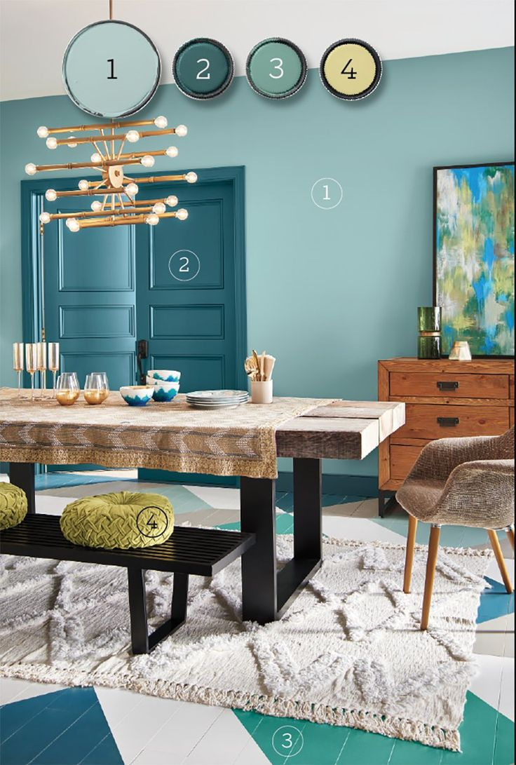Blues and greens are a foolproof combo because they neighbor each other on the color wheel. Shown here, Behr Paint's Polished Aqua (walls), Wanderlust (doors and trim), Jade Dragon (accent), That's My Lime (accent).