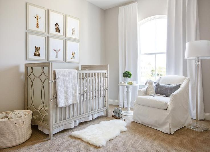 Lovely gender neutral nursery is accented with The Animal Shop Baby Animals Prints hung from a light gray wall over an RH Baby & Child Vienne Panel Crib.