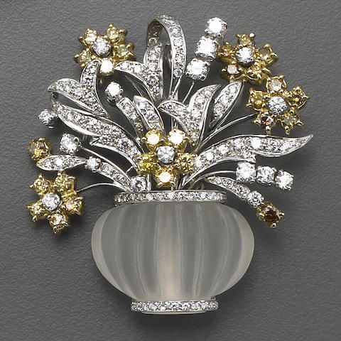 A diamond, yellow diamond, rock crystal and bicolor gold brooch.