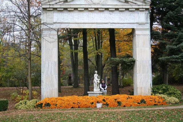 """Musidora. """"By an unknown sculptor. The marble archway is from the Imperial Bank of Canada."""" """"Guild Sculpture Garden  This is a small sculpture garden found on the outskirts of Toronto along the Scarborough Bluffs and Lake Ontario. This area displays monuments, architectural pieces and sculpture collected from buildings which were being demolished in Toronto and Southwestern Ontario between 1950 and 1981."""""""