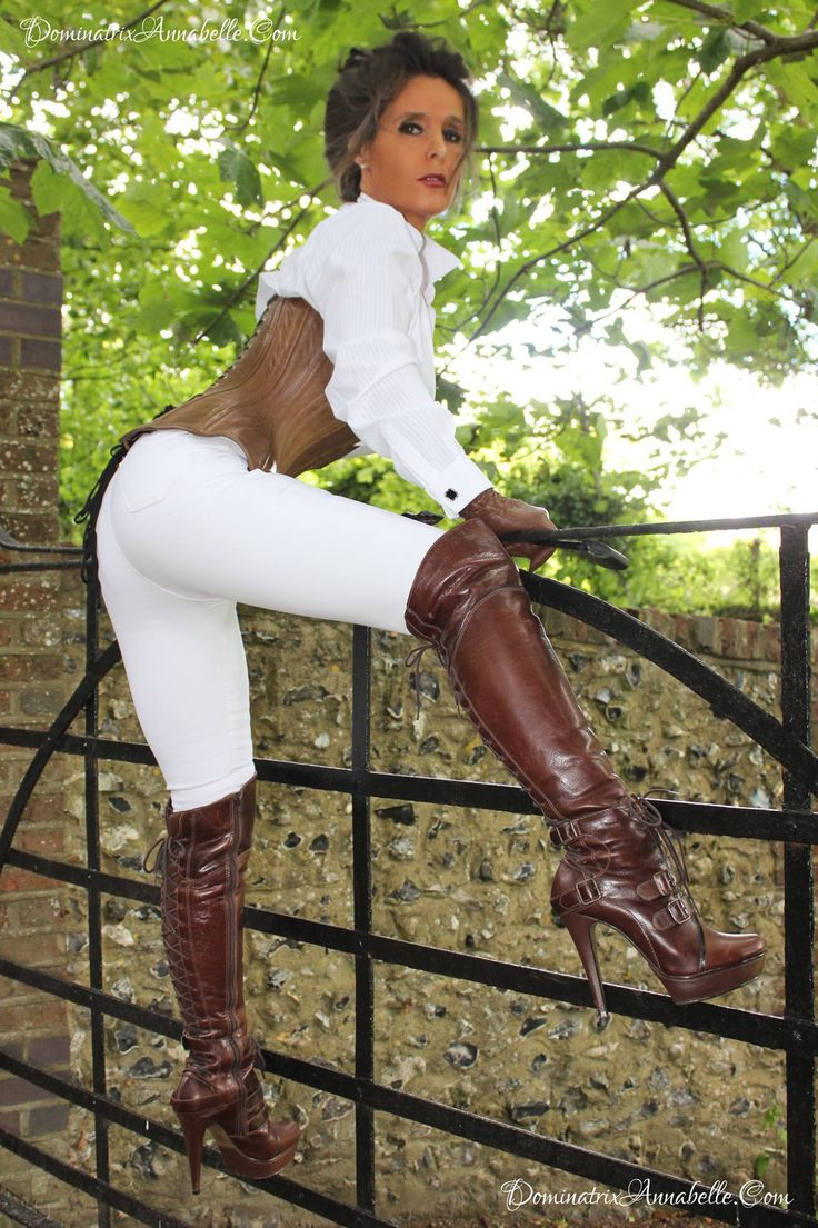 Equestrian showing off sexy boots and beautiful horse 4