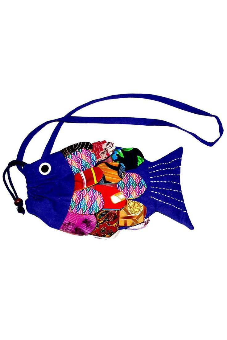 "Handmade in Thailand, this colorful fish purse is made with recycled fabric. Draw string closure. This item is handmade and size might vary slightly.    Dimensions: 10"" x 6""   Crossbody Fish Purse by Sure Design. Bags - Cross Body Canada"
