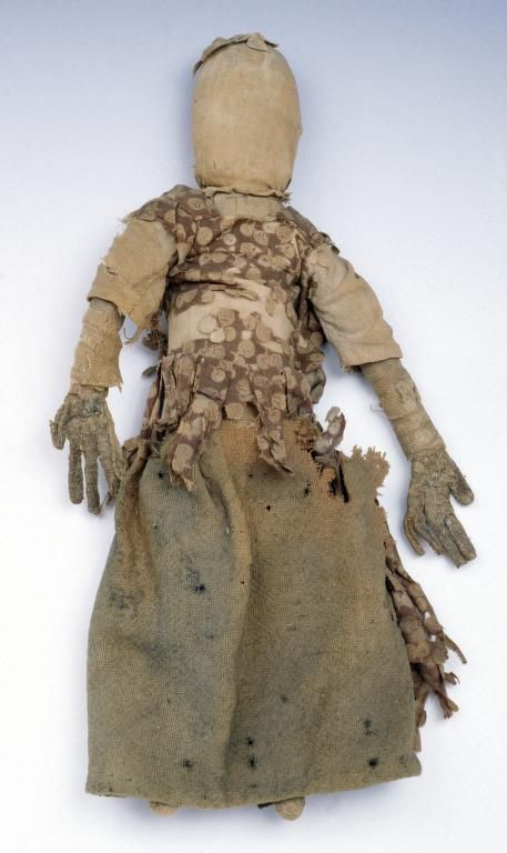 Clarissa Field of Northfield, Massachusetts, was born blind in 1765. This doll was made for her and she fancifully named it Bangwell Putt. Bangwell lacks facial features but her ten carefully constructed fingers suggest the importance of touch in Clarissa's world. Bangwell has a homespun body and is dressed in 18th century fashion, including corset. Clarissa kept Bangwell until she died in her eighties. Bangwell Putt is thought to be the oldest surviving rag doll in North America. 15.25in…