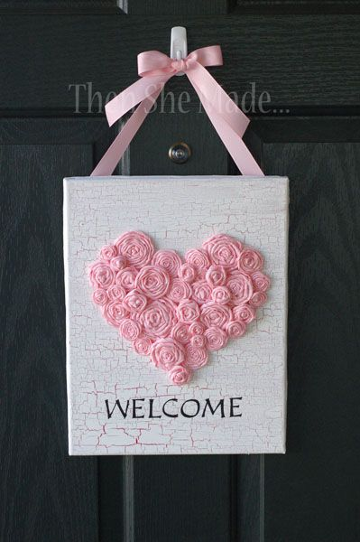 Pink heart make with roses on canvas. This would be a great decoration for Valentine's Day.