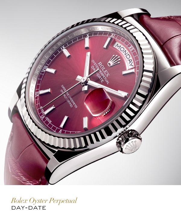The Rolex Day-Date 36mm in white gold with a fluted bezel, cherry dial and leather strap.  #Festive #RolexOfficial