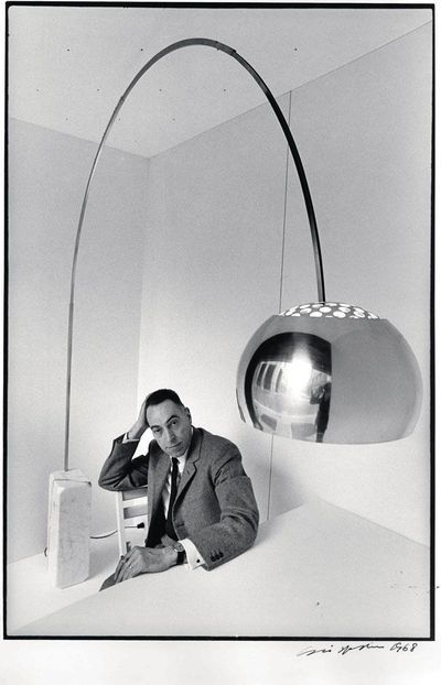 Great image of designer Achille Castiglioni with #Arco he designed for #FLOS.