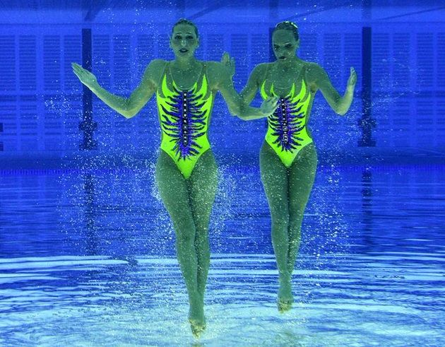 olympic synchronized swimmers appear to stand on water