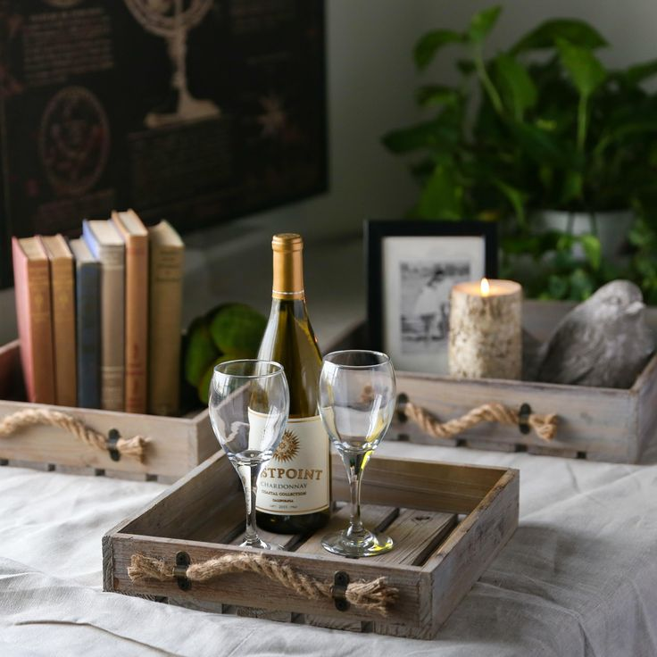 Refresh and display the beauty of what you already have by incorporating functional decor. Set of three wood square trays with rope side handles; item 56401. #homedecor #urbantrends #trays #wine #books #candle #wineglasses #farmhousedecor #rustic #casual #serve #serenity #relaxation #datenight #athome #atlantamarket #Americasmart #party #woodtray #style #interiordesign #wallart #photooftheday #classic #creative #gorgeous