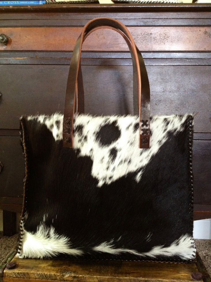 The Market Tote. Cowhide exterior, lined with two interior pockets, and leather straps. Carry books, groceries, or use as your purse. See the full line at gowestdesigns.us