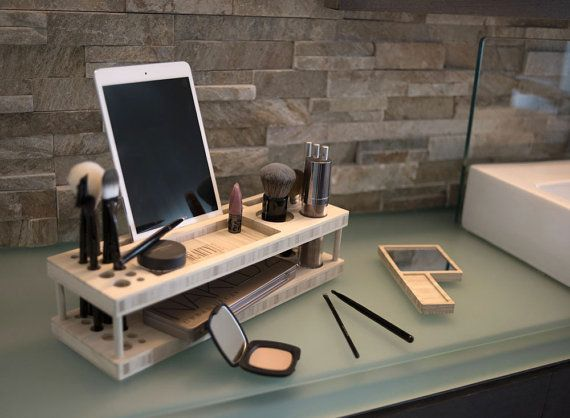 + Taylor Beauty Station is your daily makeup organizer and display tray. + Enjoy a display dock for your phone and tablet. + Created from beautiful, eco-friendly bamboo. + Handmade in the USA by iSkelter. Taylor is a member of the Beauty Station Line by iSkelter. Its a complete makeup organizer, display center, and universal docking station for your iPhone, iPad, & most phones & tablets. Each Beauty Station is chiseled and handcrafted from natural, eco friendly bamboo. The products s...