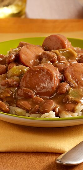 Spicy Cajun bean recipe with pinto beans and smoked sausage made easily in the slow cooker