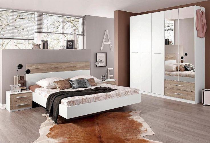 Dieses zeitlose Schlafzimmer in Weiß mit Highlights in Eichendekor ist modern und schnörkellos. Durch den von oben unsichtbaren Sockel wirkt das Bett beinahe schwerelos.