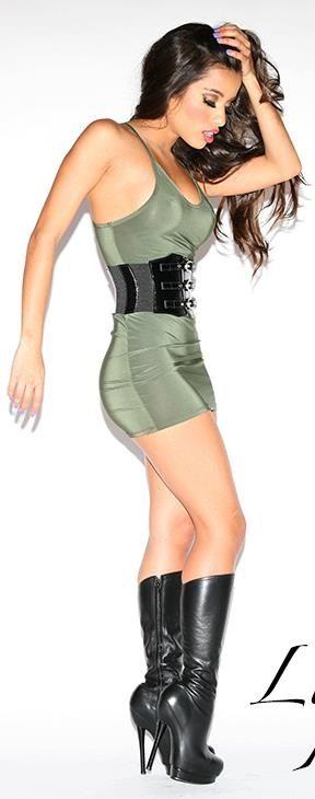 Lupe Fuentes, Olive Dress, wide blk patent belt, shiny black boots.