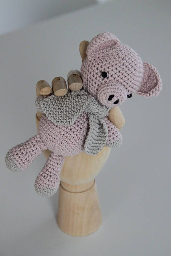 Piglet the pig, is a sweet little handmade crochet pig.  She is in 100% organic cotton. She is a little guy, in perfect grip size for a toddler or baby. From tip of ear, down to the tip of his toes, he measures 17 cm. From tip of arm to other arm he measures 10 cm.  Piglet is ready for adoption and to find his new home.