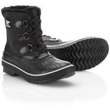 """A Definitive List of the Best Winter Boots: """"I'll jump on the Sorel bandwagon, Sorel's Tivoli collection is as at home on the snowy mountaintop as it is in a hip hop video. I wear the candy apple red pair from the 2011 collection year round, (I live in Portland and year round bootery is pretty much required) but these black glitter jams are Mariah Carey grade fabulous at a Mary Carey price. These shits are beautiful."""""""