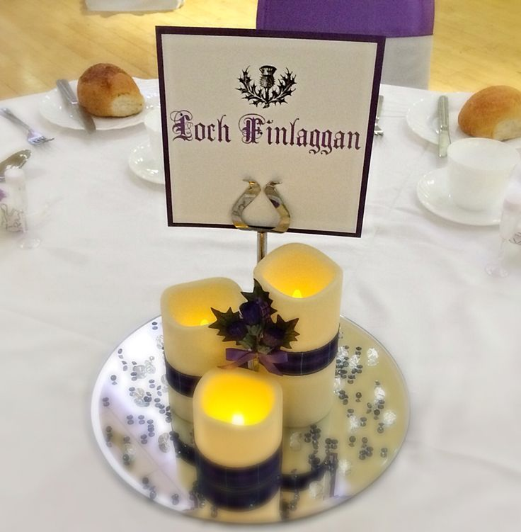 Scottish themed trio of candles centrepiece by Made Marvellous with thistle, name card and scattered crystals