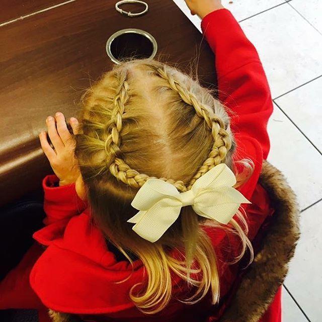 How cute is this lil hairstyle by jodie 😍😍😍!!! #2017 #salon #acutabovesalon #halewood #hairenvy #littlegirlshair #bow #braid #hair #hairstyles #prom #disco #salon