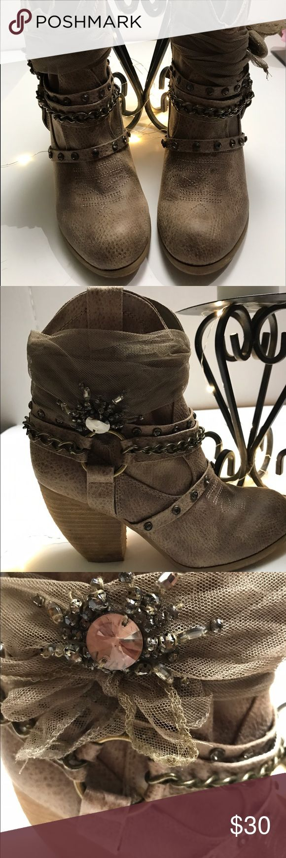 Not Rated brand cowgirl boots! These are really cute Not Rated cowgirl boots!! Only worn once ! Very cute with the ribbon with bling on it and the chains! All leather !! Not Rated Shoes Ankle Boots & Booties