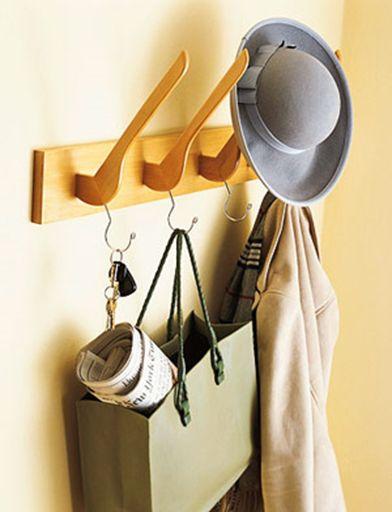 Wooden hangers transformed into a dual hat/coat rack