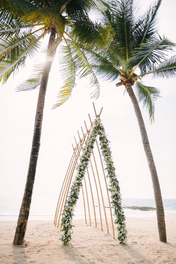 Handcrafted bamboo alter with soft ivory O\'Hara roses and  eucalyptus greens: http://www.stylemepretty.com/destination-weddings/2016/08/25/dreamy-beach-wedding-style-session-at-celebrity-destination/ Photography: Darinimages - http://www.darinimages.com/