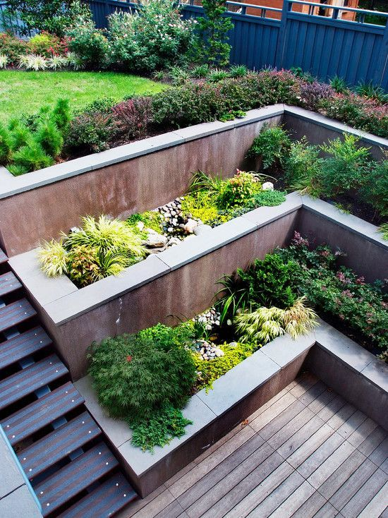 Multi level concrete retaining walls wooden deck for Landscape retaining wall design