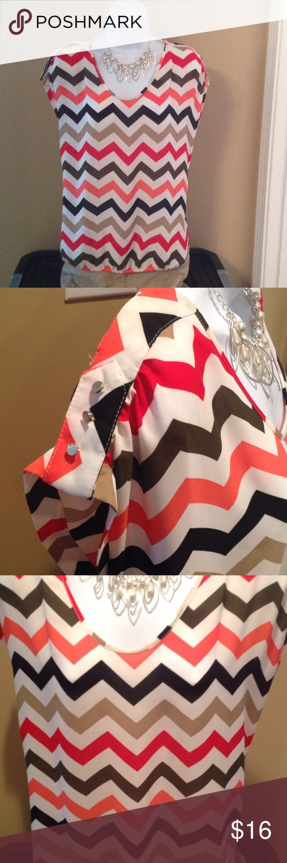 Beautiful chevron blouse Multi colored Chevron striped blouse with cute button detail on sleeves. Also has elastic around bottom roz&ali Tops Blouses