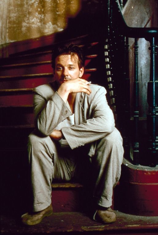Harry Angel played by Mickey Rourke in Angel Heart.   When mickey was at the top of his game. An absolutely mesmerizing performance.