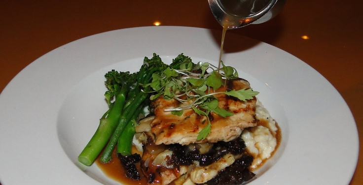 Pan seared chicken breast over grits and figs, with broccoli spear. Apple cider au jus. House on Main, Abingdon, VA