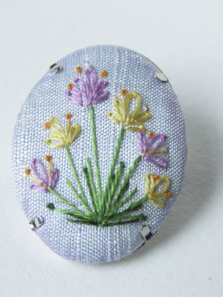 Oval Springtime crocus flower purple, yellow and blue silk embroidery brooch button. by MargDierEmbroidery on Etsy. french knots and lazy daisy stitch.