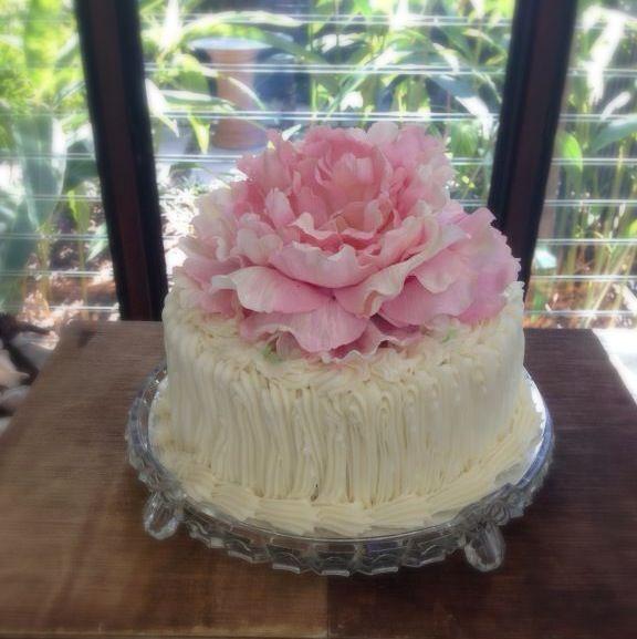 Small wedding cake. White chocolate mudcake. Peony flower
