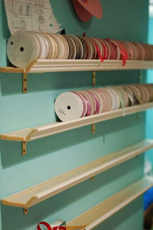Put up some crown molding shelves for larger rolls of ribbon.   45 Organization Hacks To Transform Your Craft Room