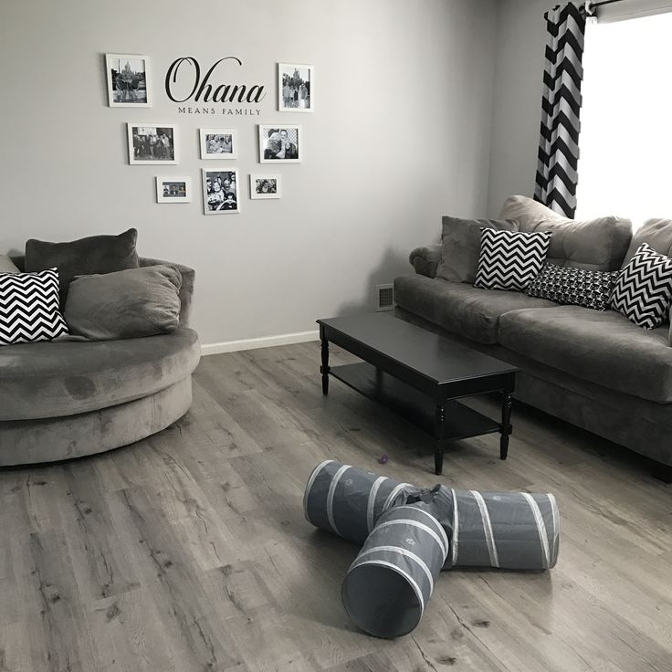 Neutral grays with ohana photo wall Floors: driftwood hickory from lumber liquidators Furniture: ashley furniture Wall color: sherwin williams cashmere in color glacial Ohana decal: jillmgray.com